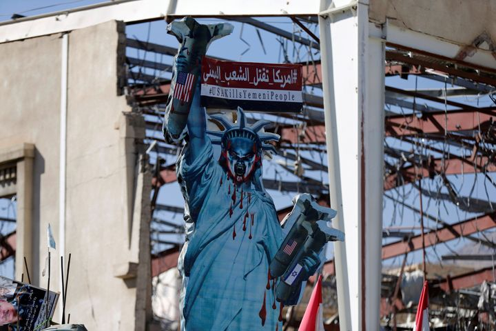 A protest sign outside a funeral hall in Sanaa, Yemen, that was hit by the Saudi-led coalition that receives U.S. support.