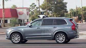 A self driving Volvo vehicle, purchased by Uber, moves through an intersection in Scottsdale, Arizona, U.S., December 1, 2017.  Photo taken on December 1, 2017.  REUTERS/Natalie Behring