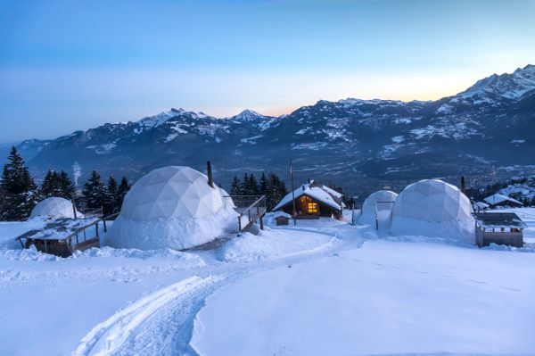 """Whitepod is an """"eco-luxury hotel"""" consisting of high-tech podsin the Swiss Alps. The pods sit on wooden platforms and o"""