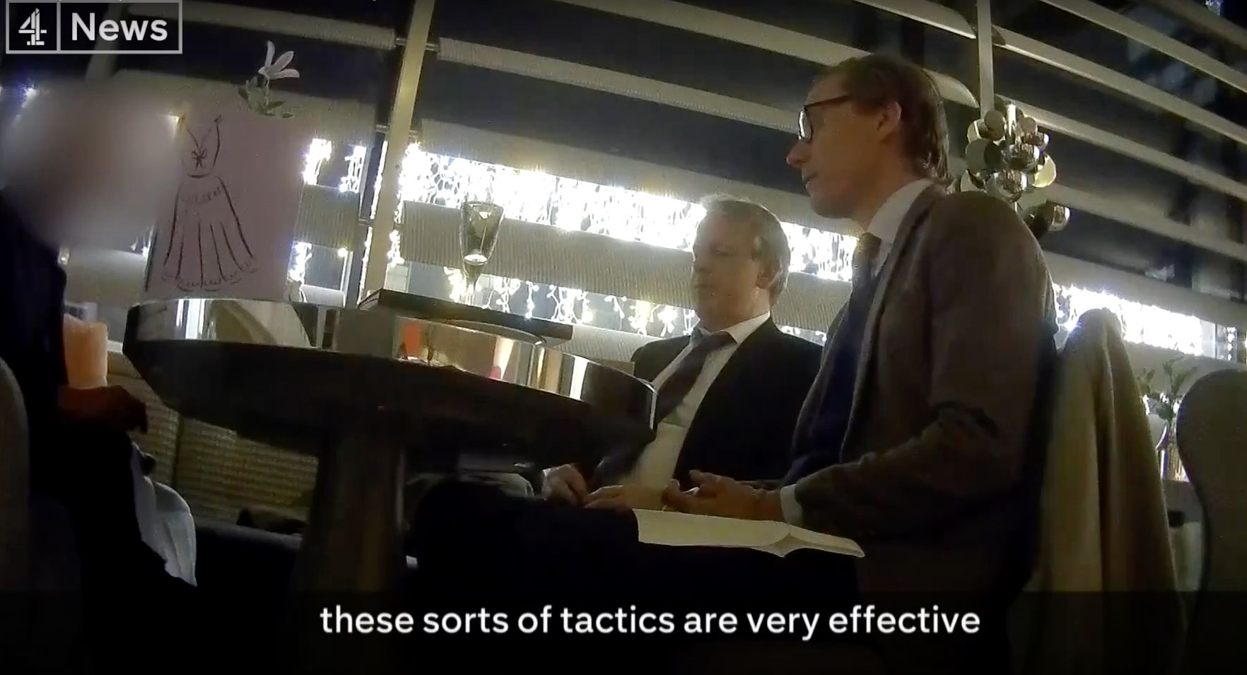 Cambridge Analytica's Alexander Nix and Mark Turnbull are seen during a secretly recorded interview with a Channel 4 reporter