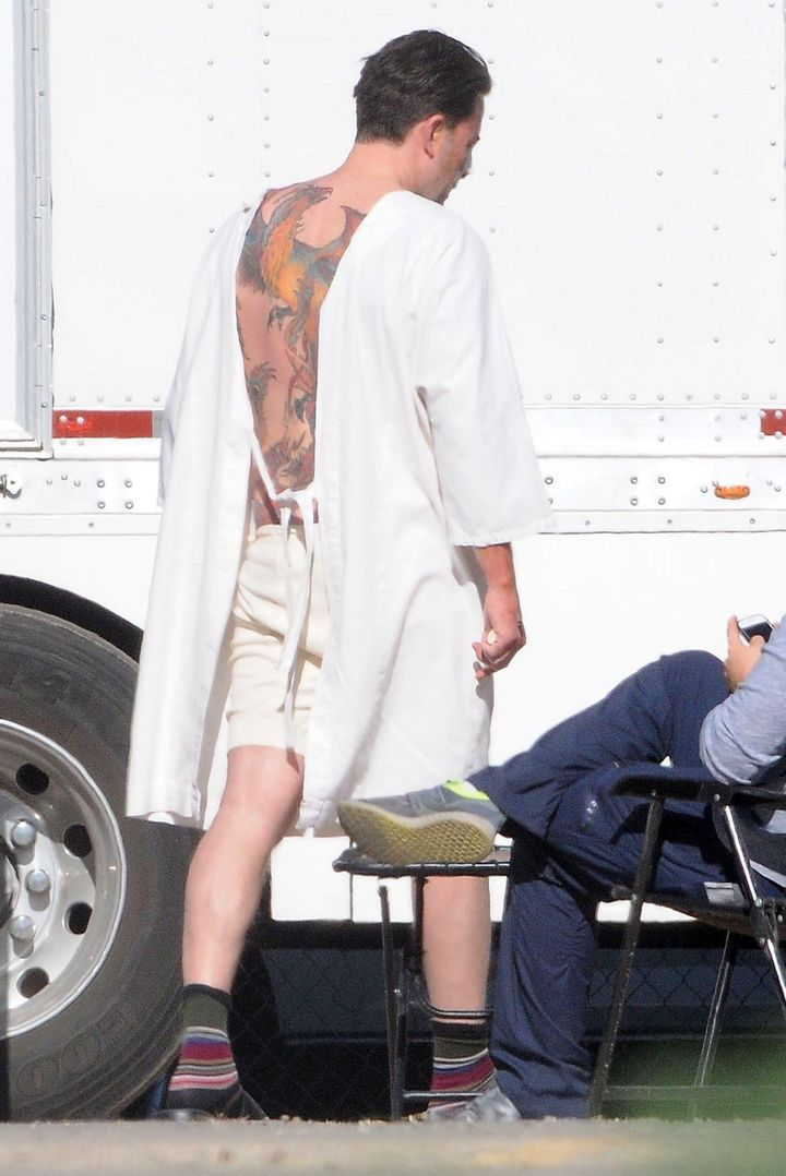 "Affleck reveals his tattoo on the set of ""Live By Night"" on Dec. 8, 2015."