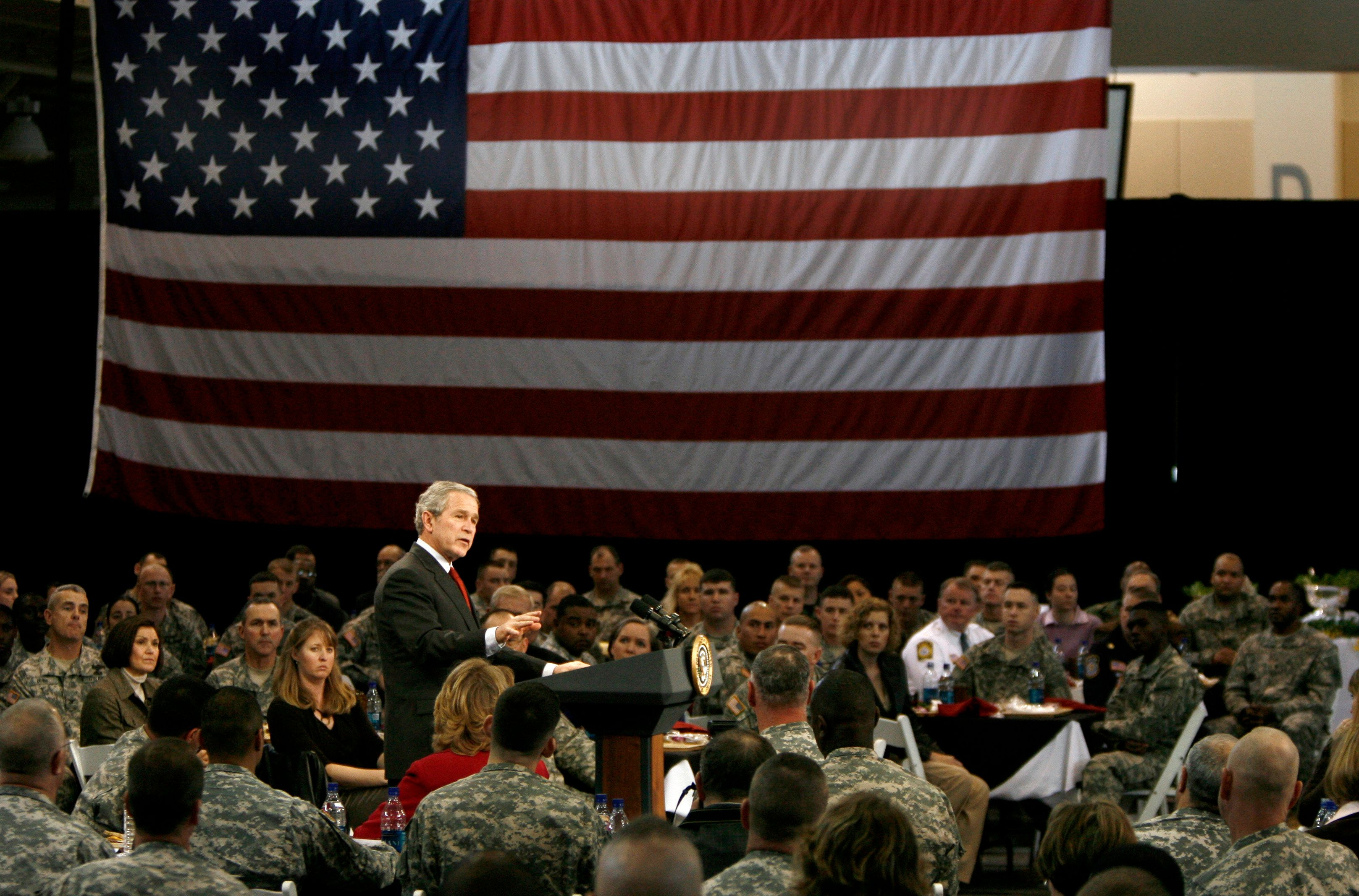 U.S. President George W. Bush speaks to U.S. troops and their families after having lunch with them at Fort Benning, Georgia, January 11, 2007. Bush's visit comes a day after a live television address on his administration's U.S. military strategy and the situation in Iraq from White House.     REUTERS/Jason Reed  (UNITED STATES)