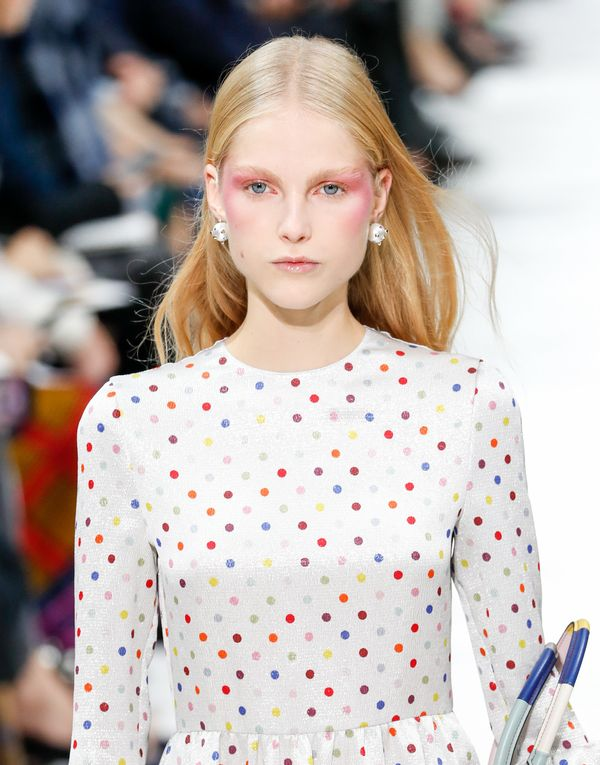 "McGrath also created this rosy look, <a href=""https://www.vogue.com/article/valentino-spring-2018-beauty-hair-makeup-draped-s"