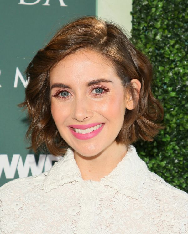 "Alison Brie's shimmery light pink eye look, paired with a bubblegum pink lip, is a perfect look for spring. The ""Glow"" star s"