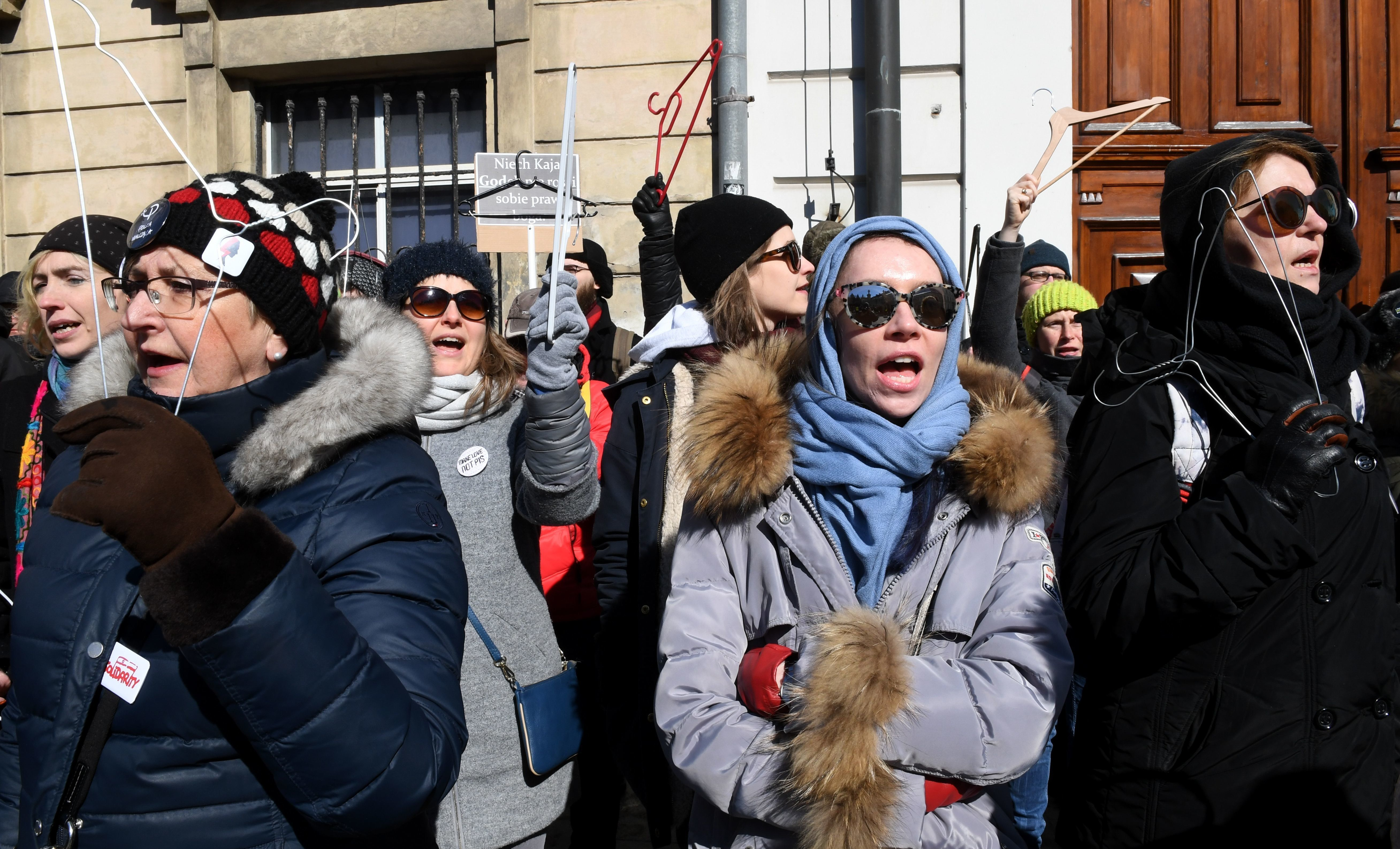 Women hold up coat hangers as they demonstrate in front of the seat of the Warsaw archdiocese on March 18, 2018 in a protest against what they call the Catholic Churchs intrusion into politics by supporting a new measure to tighten the already restrictive law on abortion. / AFP PHOTO / JANEK SKARZYNSKI        (Photo credit should read JANEK SKARZYNSKI/AFP/Getty Images)