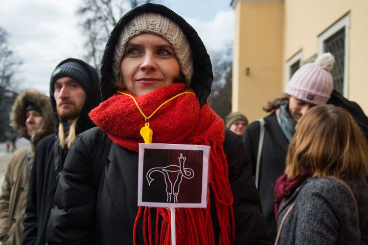 A female protesterholds a sign during thedemonstrationin Krakow.