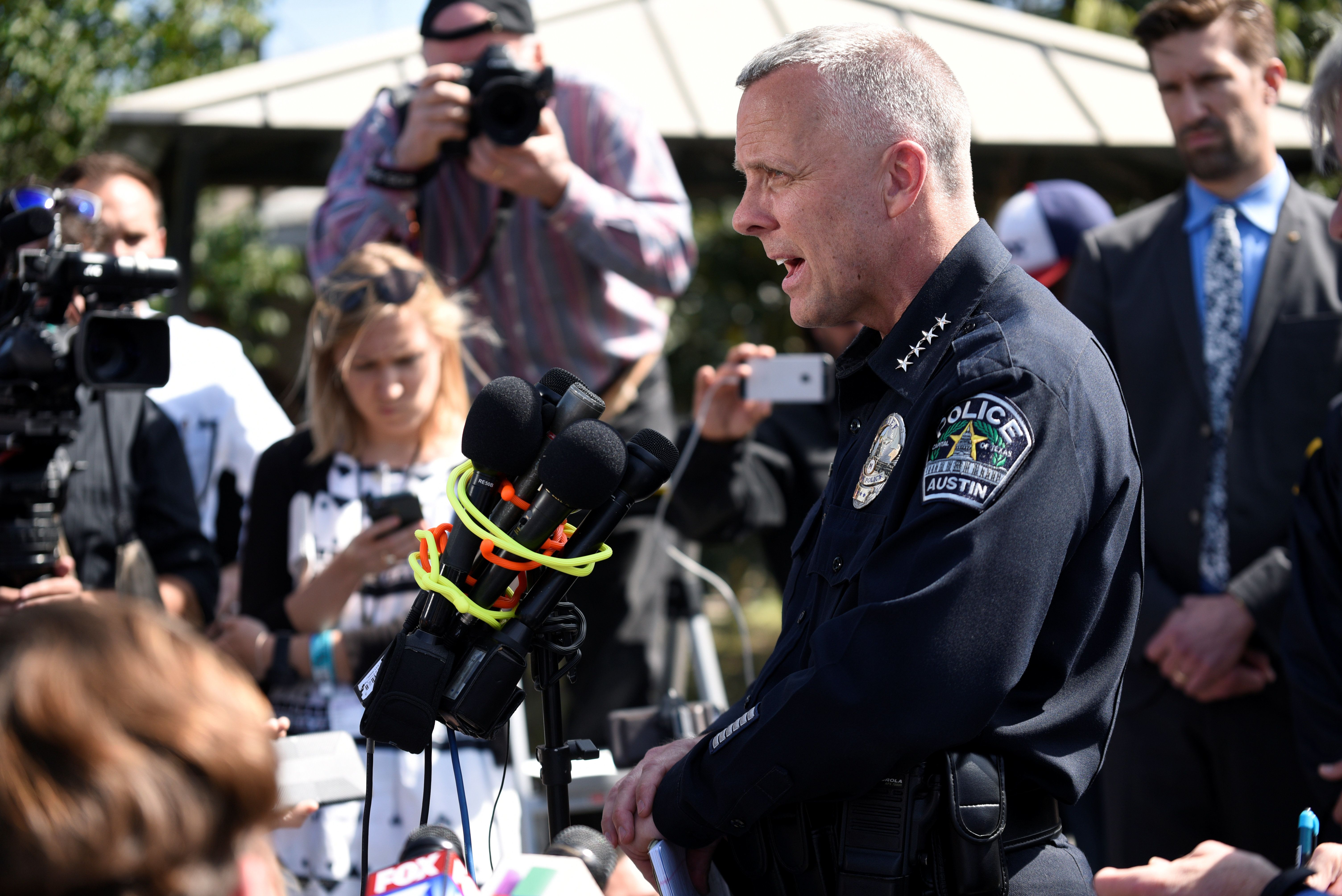 Austin Police Chief Brian Manley speaks during a news conference near the scene where a woman was injured by a pack