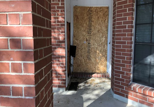 The doorway of a home that was hit with a fatal parcel bomb on March