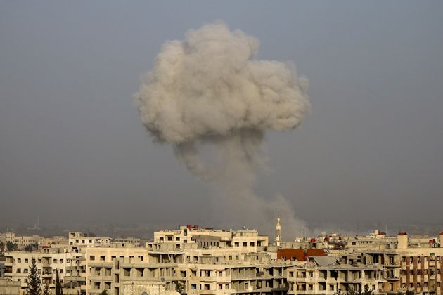 Smoke rises after airstrikes on eastern Ghouta's town of Kafr Batna in Syria on