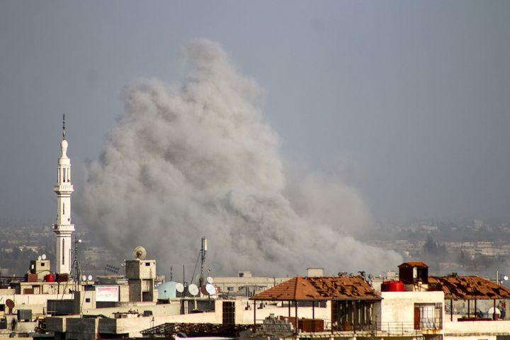 Smoke rises over Kafr Batna on Friday.