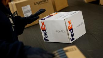 Packages are sorted inside the FedEx Corp. distribution hub at Los Angeles International Airport (LAX) in Los Angeles, California, U.S., on Monday, Dec. 15, 2014. FedEx Corp. is scheduled to release earnings figures on Dec. 17. Photographer: Patrick T. Fallon/Bloomberg via Getty Images
