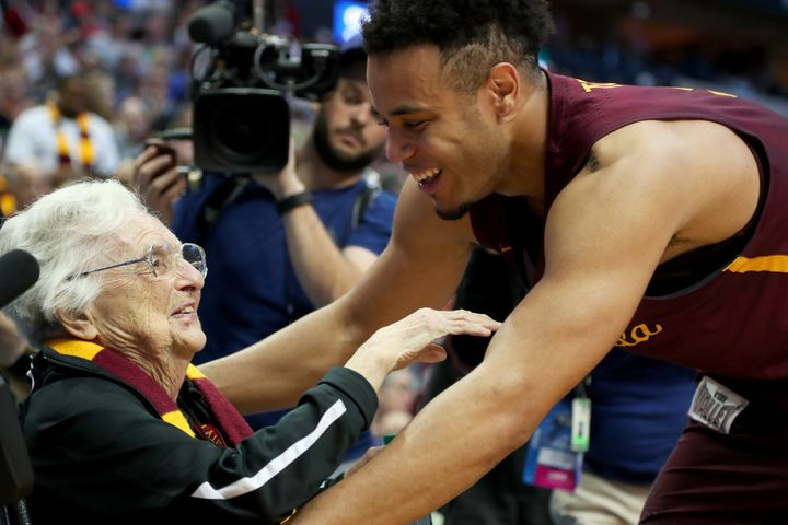 Sister Jean Dolores-Schmidt and Marques Townes celebrate Loyola University Chicago's upset victory over the University o