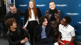 NEW YORK, NY - NOVEMBER 01:  (Clockwise from top left) SiriusXM host Tim Stack poses for photos with actors Sadie Sink, Millie Bobby Brown, Caleb McLaughlin, Finn Wolfhard and Gaten Matarazzo during SiriusXM's 'Town Hall' cast of Stranger Things on SiriusXM's Entertainment Weekly Radio on November 1, 2017 in New York City.  (Photo by Astrid Stawiarz/Getty Images for SiriusXM)