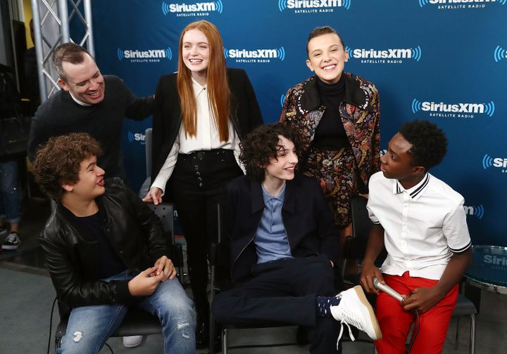 "Some of the young cast members of ""Stranger Things,"" pictured in November with host Sirius XM host Tim Stack, are getting ric"