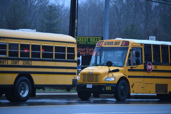 School buses are seen near the school.