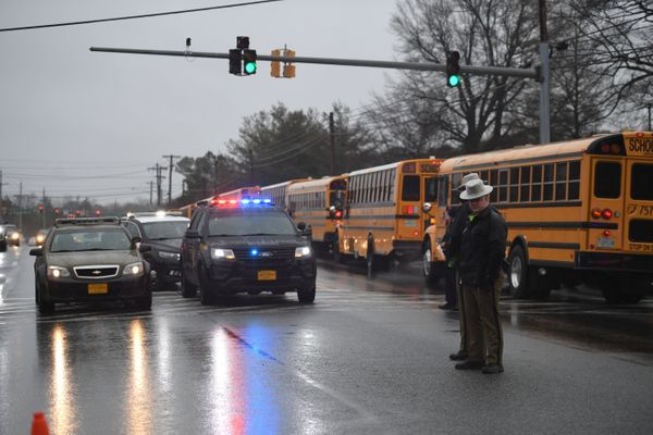 School buses, security and state troopers at the scene.