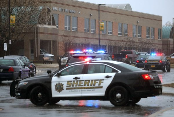 Police vehicles are parked in front of Great Mills High School after a shooting on March 20, 2018 in Great Mills, Maryland.&n
