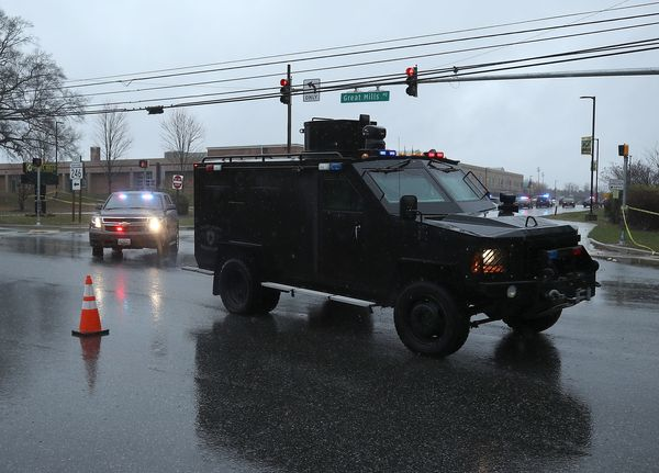 Police vehicles pull out of Great Mills High School.
