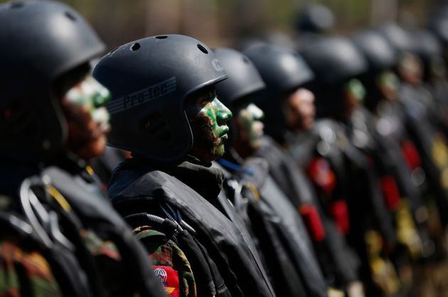 Myanmar miltary commandos stand in formation during exercises on Feb. 3,