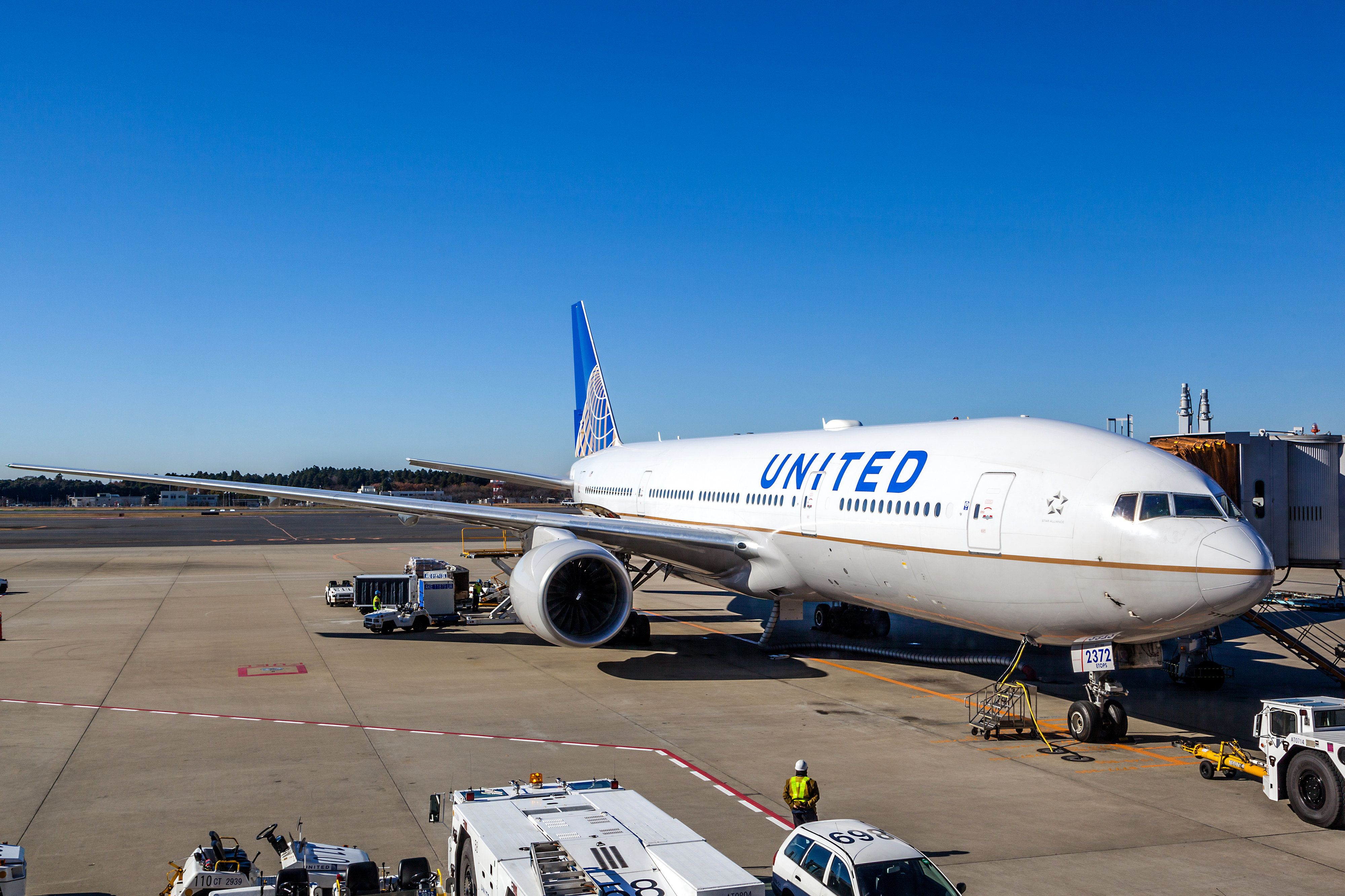 Tokyo, Japan - December 5, 2014: A United Airlines plane being serviced on the tarmac of Narita Airport. After its merger with Continental in 2010, United has become the world's largest airline.