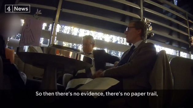 Alexander Nix in the foreground discussing CA's secret email