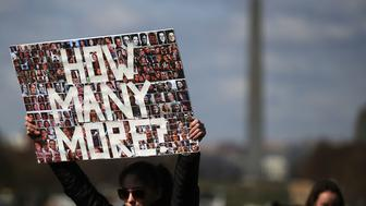 WASHINGTON, DC - MARCH 14: A student holds up a sign during a rally at the U.S. Capitol to urge Congress to take action against gun violence on March 14, 2018 on Capitol Hill in Washington, DC. It was one month ago today that a gunman killed 17 people at Marjory Stoneman Douglas High School in Parkland, Florida.  (Photo by Mark Wilson/Getty Images)