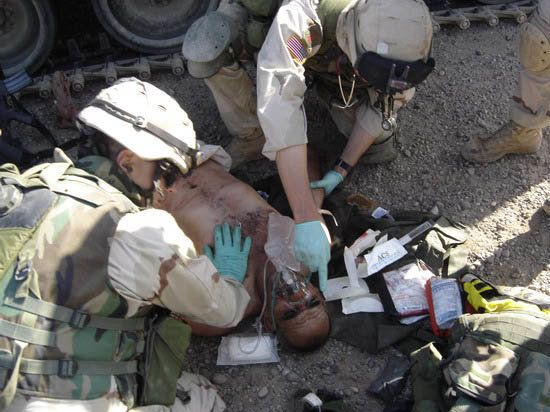 Jason Hartley posted this photo of soldiers helping a wounded Iraqi to his blog.