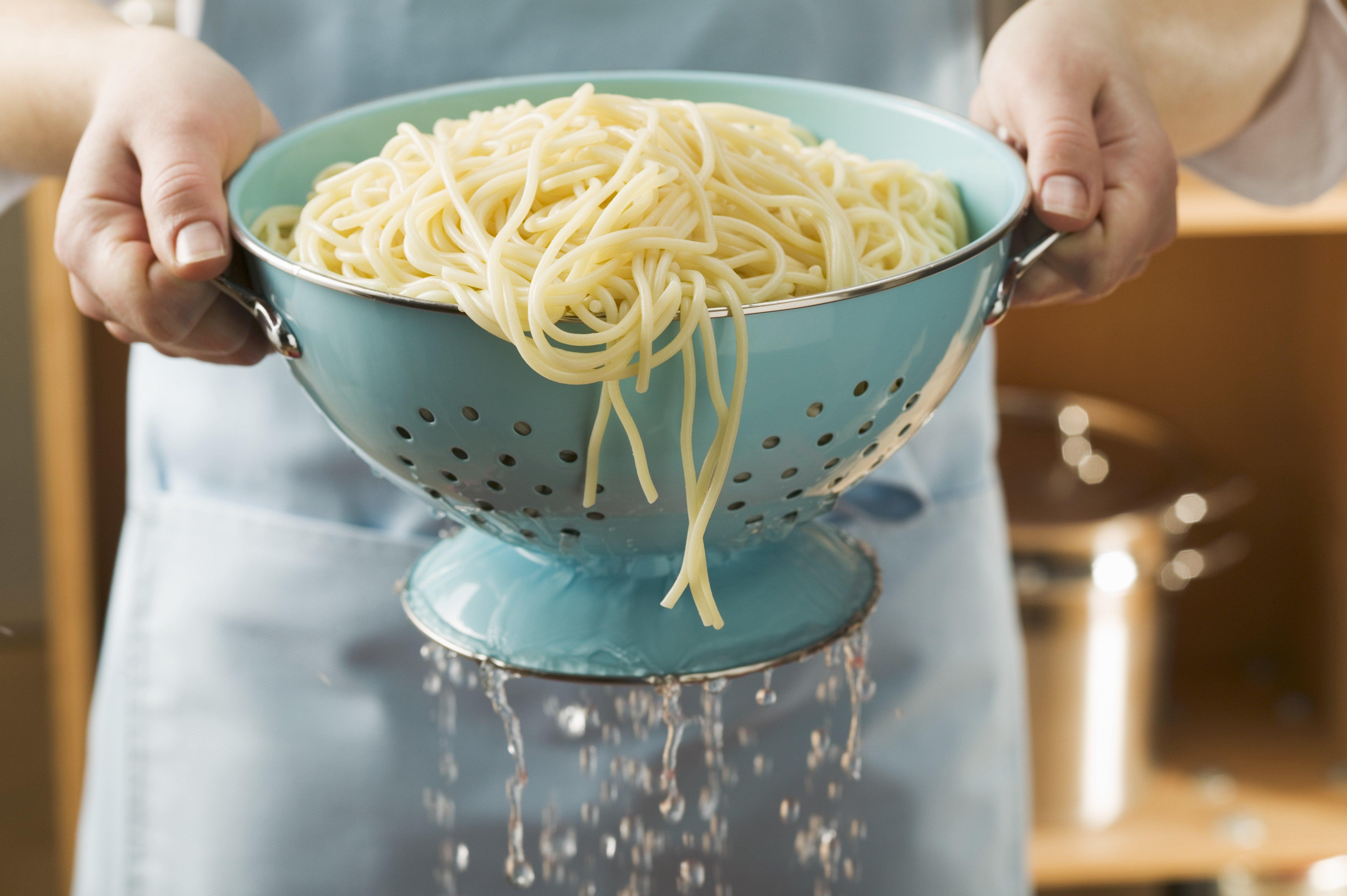 Draining cooked spaghetti