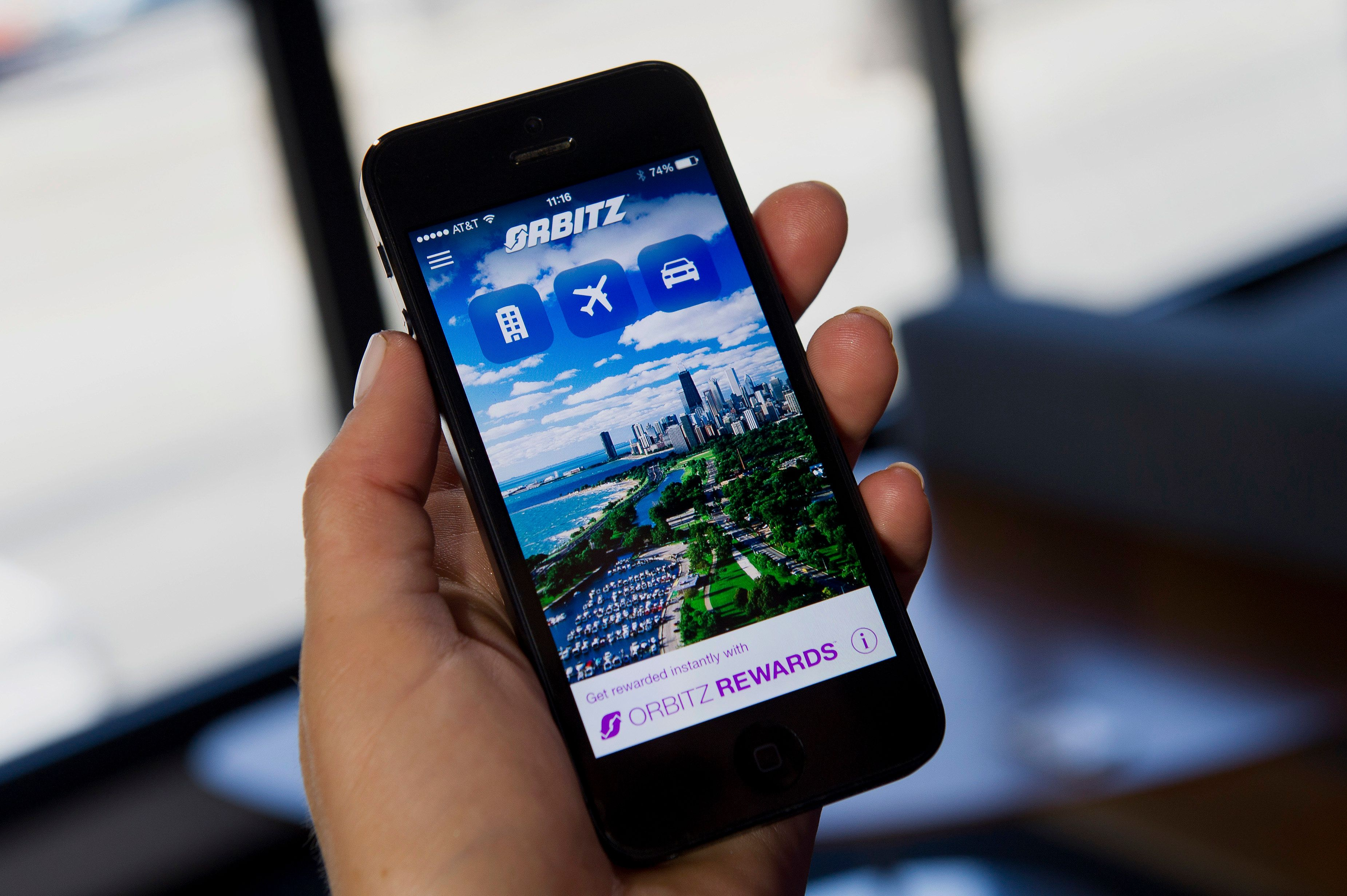 The Orbitz Worldwide Inc. application (app) is displayed for a photograph on an Apple Inc. iPhone 5 in San Francisco, California, U.S., on Friday, Aug. 8, 2014. Orbitz Worldwide Inc.'s second-quarter earnings surged as the travel-booking website benefited from higher demand. Photographer: David Paul Morris/Bloomberg via Getty Images