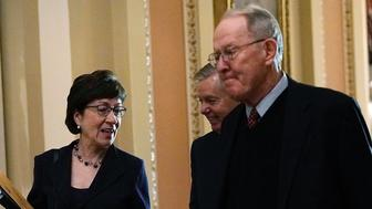 WASHINGTON, DC - DECEMBER 19:  (L-R) U.S. Sen. Susan Collins (R-ME), Sen. Lindsey Graham (R-SC) and Sen. Lamar Alexander (R-TN) arrive for a Senate Republican policy luncheon at the Capitol December 19, 2017 in Washington, DC. The House has passed the tax overhaul bill and the Senate is expected to vote on the bill soon.  (Photo by Alex Wong/Getty Images)