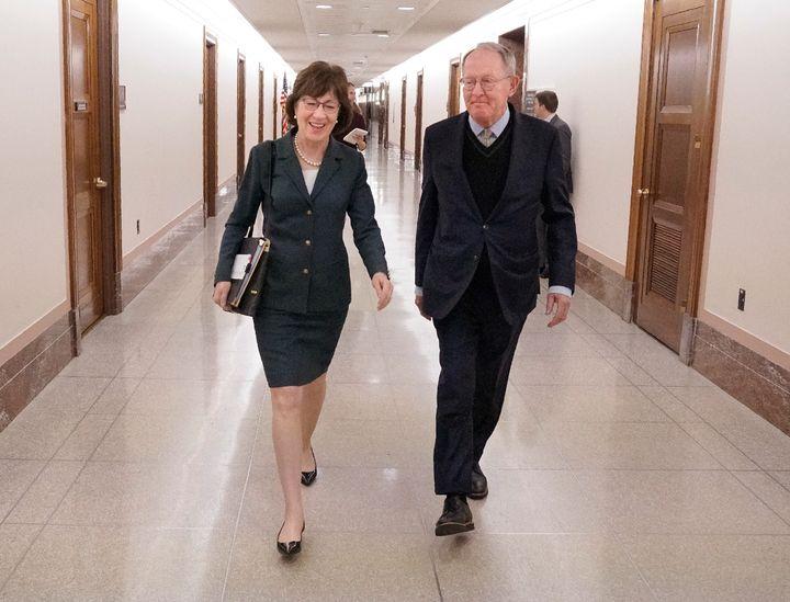 Sen. Susan Collins (R-Maine) walks with Sen. Lamar Alexander (R-Tenn.) after a hearing on Capitol Hill on Dec. 12, 2017.&nbsp