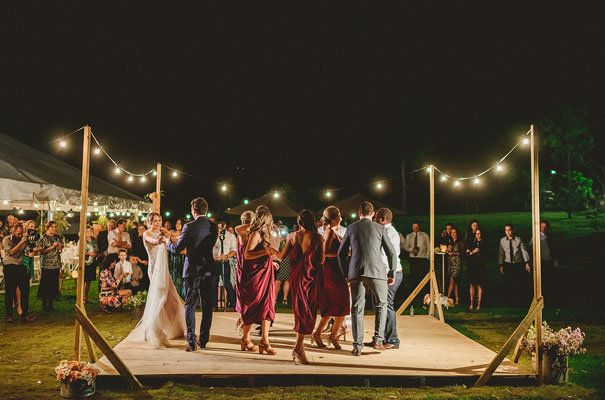 Play your first dance song and invite guests to come up and dance alongside you.