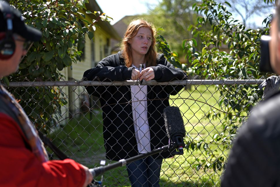 Katelyn Ferguson, 20, gives an interview outside her home, up the street from where a woman was injured in a package bomb exp