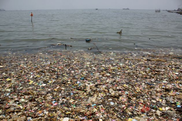 Plastic waste is seen on the north coast of Jakarta on Thursday, March 15,