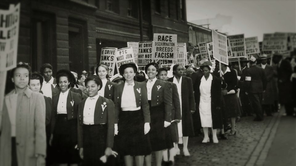 Peace Mission followers at an anti-segregation rally held by the church.