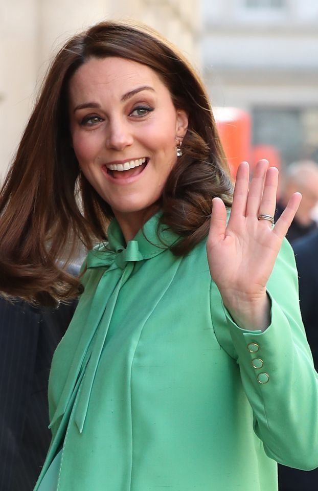The Duchess wore a bespoke Jenny Packham coat, with a bow necktie, and accessorized with earrings she's worn before.