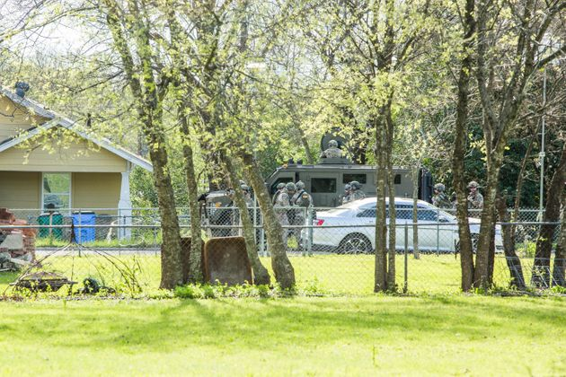 Police barricade the area surrounding the home of suspected Austin bomber Mark Anthony Conditt in Pflugerville,