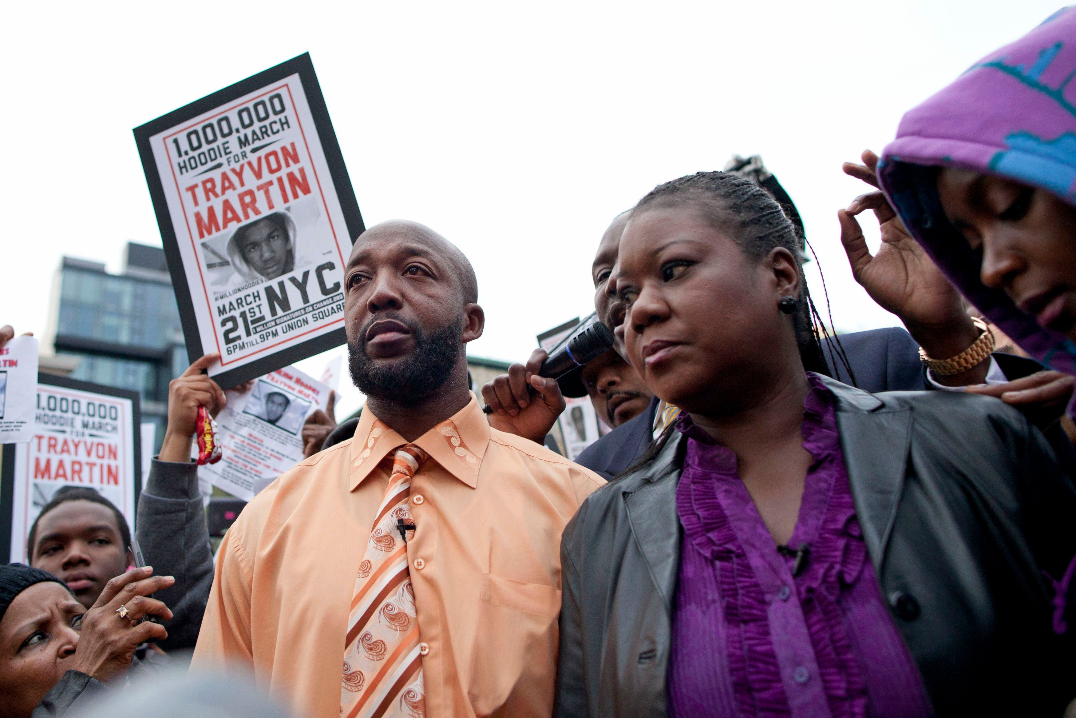 "Tracy Martin (L), father of slain Florida teen Trayvon Martin, and Sybrina Fulton, Trayvon Martin's mother, join a protest called ""A Million Hoodies March"" to demand justice for their son's death in New York's Union Square March 21, 2012. Martin, 17, wore a hooded sweatshirt when he was killed last month in a gated community in Sanford, Florida, by neighborhood watch volunteer George Zimmerman. The incident has drawn national attention and sparked debate over Florida's ""Stand Your Ground"" law since Zimmerman, 28, has claimed self-defense in the fatal shooting. The police have declined to arrest him.  REUTERS/Andrew Burton (UNITED STATES - Tags: CIVIL UNREST CRIME LAW)"