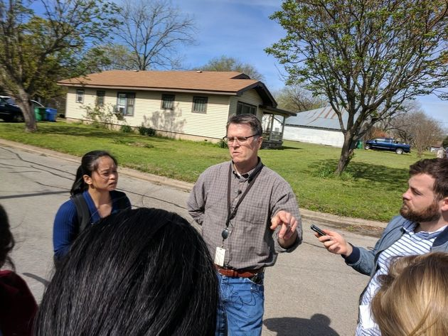 Mark Roessler, center, who lives across from Mark Conditt's house in Pflugerville, said he saw a man...