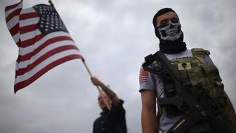 RICHARDSON, TX - DECEMBER 12:  Armed protesters from the so-called Bureau of American-Islamic Relations (BAIR), stage a demonstration in front of the Islamic Association of North Texas at the Dallas Central Mosque on December 12, 2015 in Richardson, Texas. About two dozen members of the group protested in front of the mosque, as counter-protesters demonstrated across the street. The Dallas area had become a focal point for Islamophobia, even before the Islamic extremist-inspired mass shooting on December 2, 2015 in San Bernadino, California.  (Photo by John Moore/Getty Images)