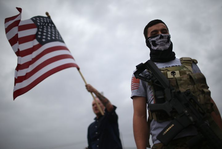 An armed protester from the so-called Bureau of American-Islamic Relations  outside the Islamic Association of North Tex