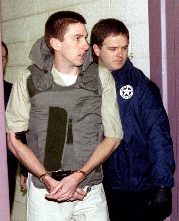 Oklahoma City bomber Timothy McVeigh is escorted from jail in 1996. McVeigh wanted to ignite a race war and wrest the America