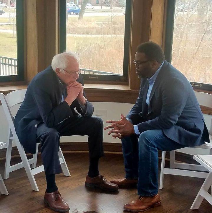 Brandon Johnson, a schoolteacher, meets with Sen. Bernie Sanders (I-Vt.) in February. Sanders and his organization Our Revolu