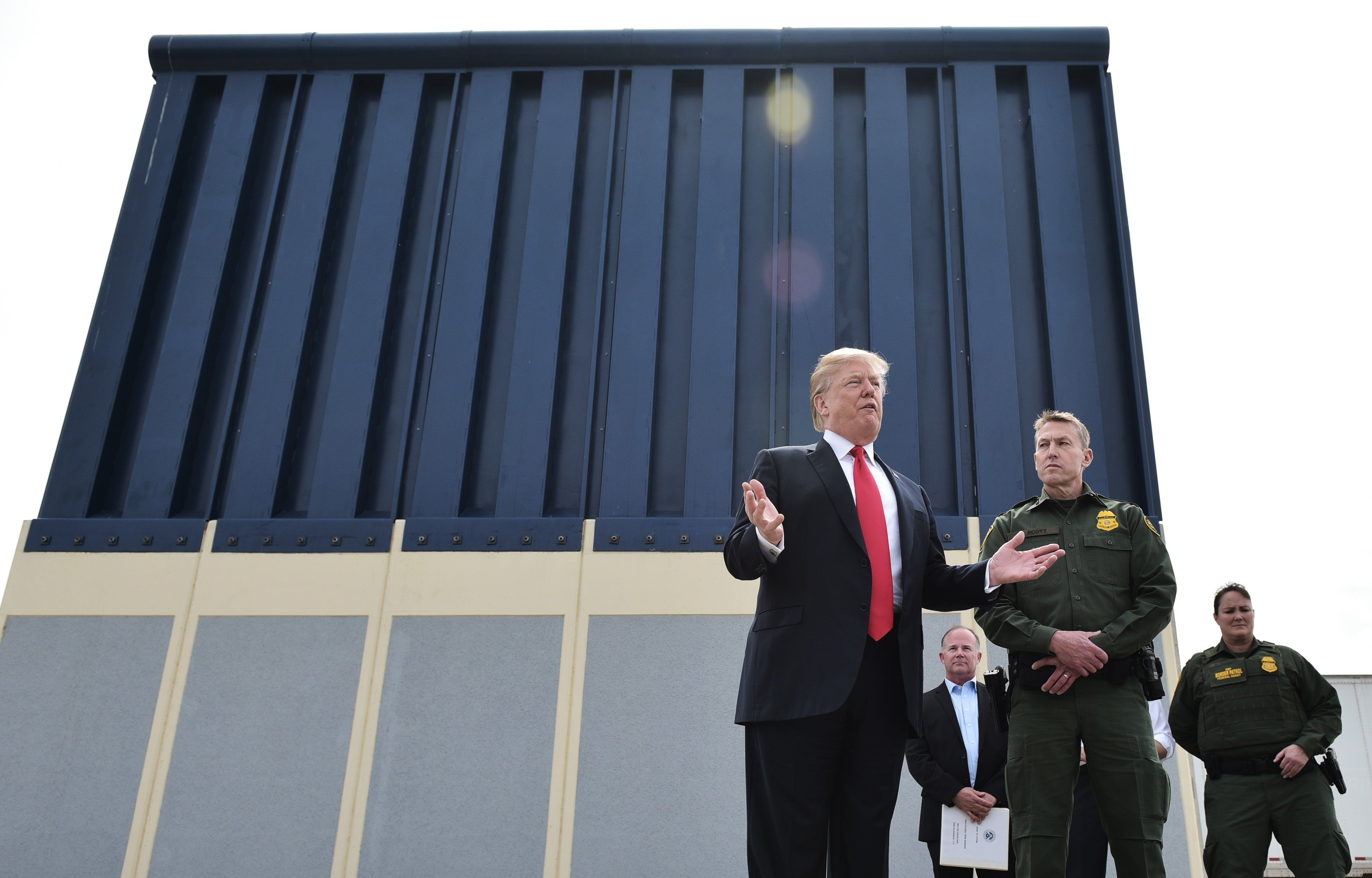 US President Donald Trump speaks during an inspection of border wall prototypes in San Diego, California on March 13, 2018. Donald Trump -- making his first trip to California as president -- warned there would be 'bedlam' without the controversial wall he wants to build on the border with Mexico, as he inspected several prototype barriers. The trip to the 'Golden State' -- the most populous in the country and a Democratic stronghold -- was largely upstaged by his own announcement that he had sacked Secretary of State Rex Tillerson.  / AFP PHOTO / MANDEL NGAN        (Photo credit should read MANDEL NGAN/AFP/Getty Images)