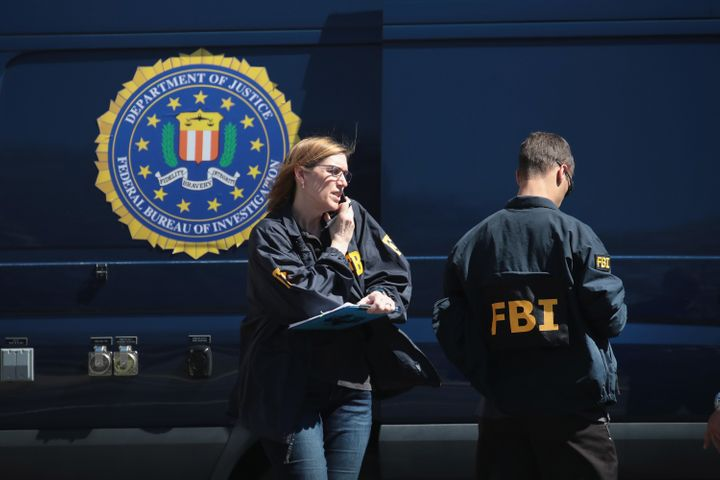 FBI agents collect evidence at a Sunset Valley, Texas, package sorting facility on Tuesday.