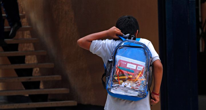 A student wearing a transparent backpack.