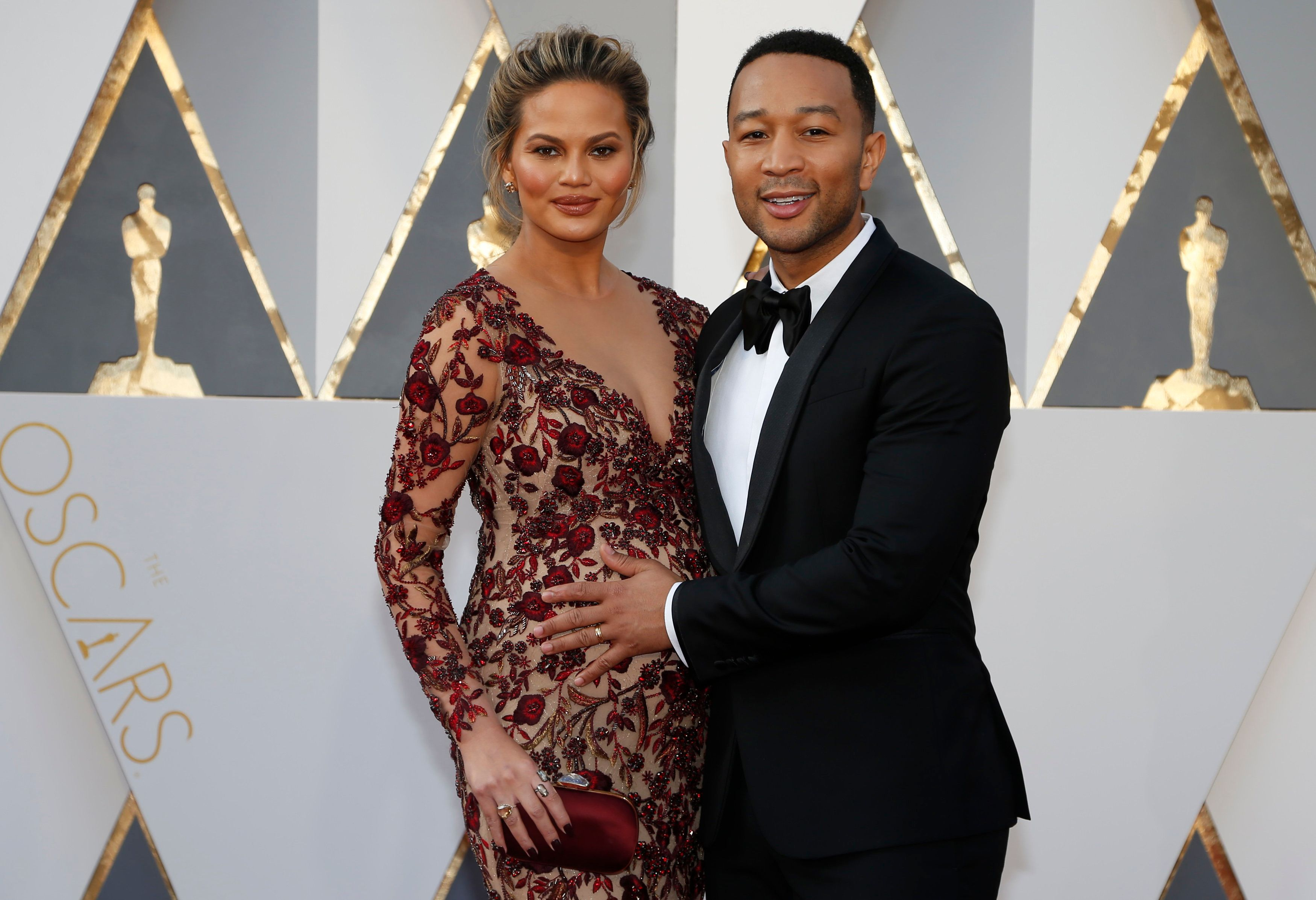 Singer John Legend and wife Chrissy Teigen arrive at the 88th Academy Awards in Hollywood, California February 28, 2016.  REUTERS/Lucy Nicholson