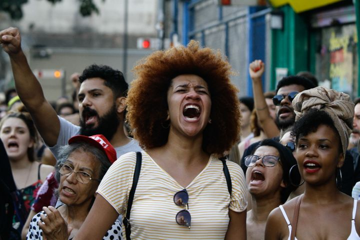 Demonstrators in São Paulo react with grief and anger on March 18, 2018, several days after Marielle Franco was shot d