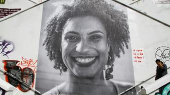 A big collage with photo of Deputy Mayor of Rio de Janeiro Marielle Franco, is seen in the stairwell of Cristiano Viana Street, in the neighborhood of Pinheiros, West zone of the city of Sao Paulo, this Wednesday 21 March 2018. The Councillor was shot to death on Wednesday night 14 March 2018, in the Centre of the city of Rio de Janeiro.  (Photo by Fabio Vieira/FotoRua/NurPhoto via Getty Images)