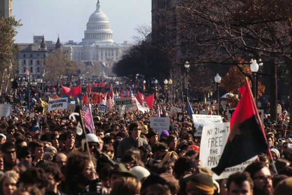 The U.S. Capitol looms in the background as thousands march along Pennsylvania Avenue on Nov. 15, 1969 for the Moratoriu